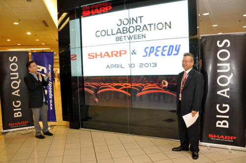 From L-R: Chuan Hooi Keat, Managing Director, Speedy Video Distribution and Hiroyuki Nuizato, Managing Director of Sharp-Roxy Sales & Service Company (M) unveiling the new video wall at the Movie Magic concept store.