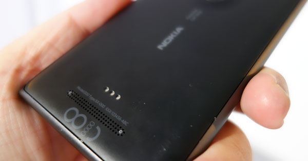 Bottom rear: The three metal dots are the contact points for the wireless-charging snap-on case; sold separately. Below that is the Lumia 925's speaker.