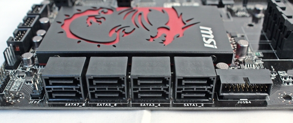 The leftmost stack of SATA connectors are connected to the ASMedia ASM1061 controller, while the rest are provided by the chipset. The system panel connector is to the left of the entire stack of SATA connectors and the USB 3.0 expansion connector is to its right.