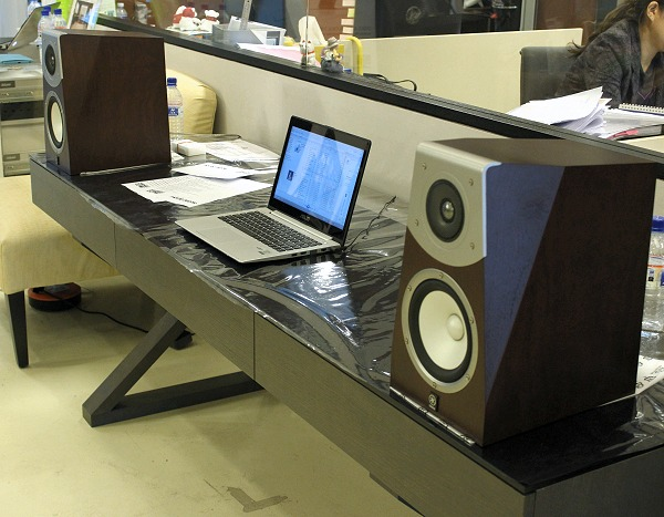 Here's the handsome Yamaha Soavo-2, two-way bass-reflex bookshelf speakers that were set on table distanced from the main presentation area that pretended to be an audio setup for a secondary zone. With an iPad and Yamaha's iOS app, it's a cinch to control what you want it to output.