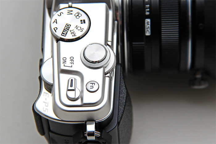 The E-P5 sports proper twin control dials, heads above the tall cylinder control dial of the E-P3.