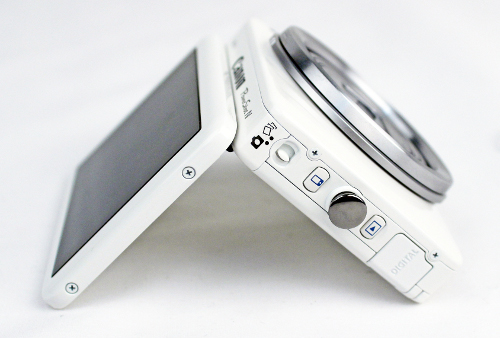 While the PowerShot N's display is able to tilt up 90 degrees, a pity it doesn't swing out sideways. On this side of the camera (right side) are the Creative Shot mode switch, Mobile Device Connect and Playback buttons.