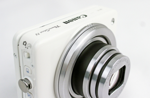 The larger ring with the three notches is the zoom ring, while the smaller one with the three indents is the shutter ring.