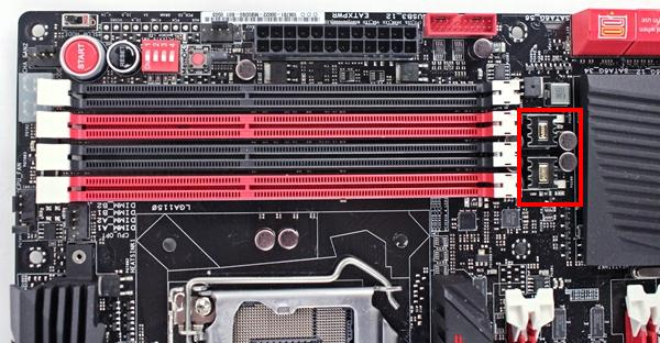 The Blackwing chokes and the 10K black metallic capacitors, highlighted by the red frame, form part of the power delivery system for the DIMM slots.
