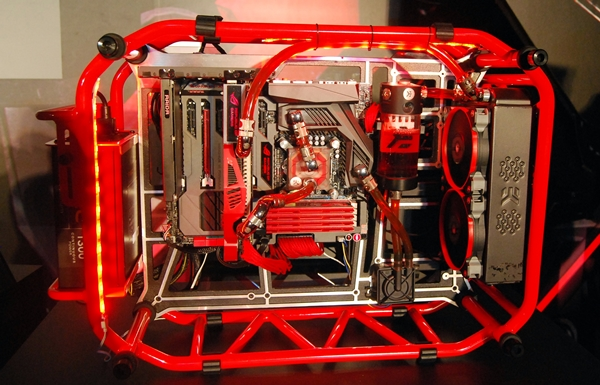 The concept gaming platform at the event consisted of the Maximus VI Formula board and the Poseidon graphics card. They were both liquid-cooled and housed in what resembled a red roll cage of a stock racing car.