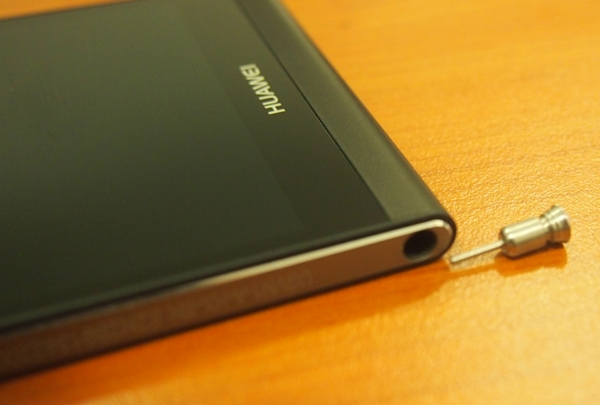The metallic pin can be used to eject the SIM card and memory card trays on the other side of the Huawei Ascend P6.