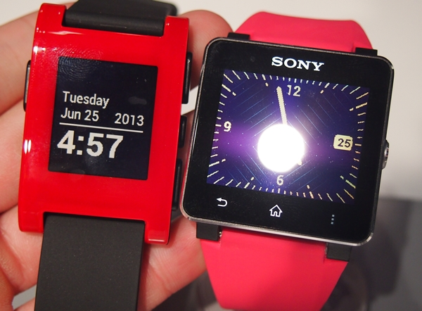 Seen here are the red Pebble watch (left) and the Sony SmartWatch 2 (right).
