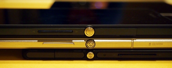 The metallic power button is the signature look of Sony's flagship devices. <br> The Sony Xperia Z (top), the Sony Xperia Z Ultra (center) and the Sony Xperia Tablet Z (bottom).