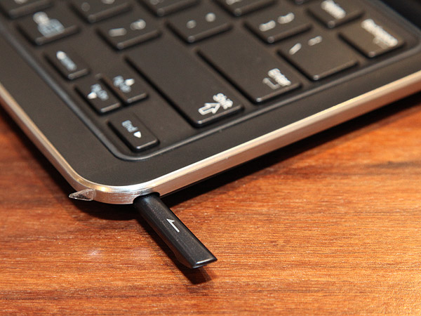 The stylus on the ATIV Q is hidden on the lower right hand corner of the keyboard.