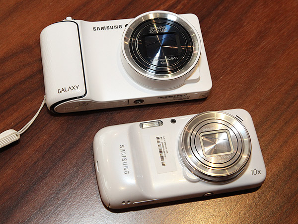 The new Galaxy S4 Zoom (below) compared with the older Samsung Galaxy Camera (above).