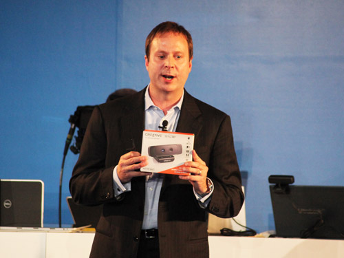 Kirk Skaugen, senior vice president and general manager of Intel's PC Client Group with the retail version of the Creative Senz3D interactive gesture camera.