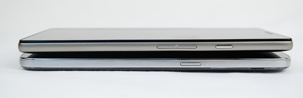 The Power button on the Samsung Galaxy Mega with LTE (bottom) is deliberately located closer to the middle for easier access so that you need not stretch your thumb. However, it's a little too accessible and easy to engage the button in casual handling - we've had our fare share of switching off the phone accidentally.