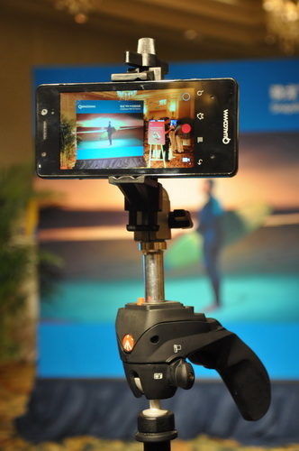 This prototype smartphone is mounted on a tripod to demonstrate the device's 4K Ultra HD video recording capability.
