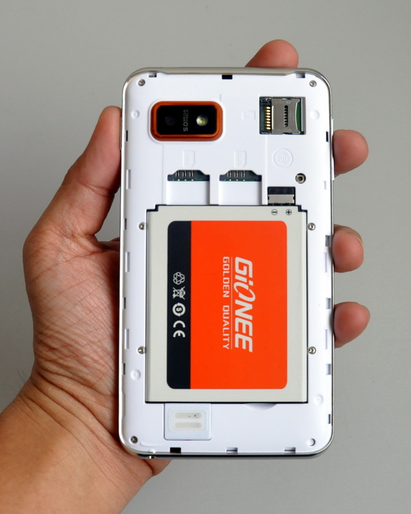 Seen in this photo are the phone's two SIM slots, microSD slot, and the bundled 2100mAh battery module.