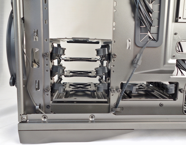 Looking at the opposite side, you can notice that we secured the drive enclosures with thumbscrews. Notice the cut-out on the right only accommodates the 1-drive 3.5-inch drive enclosure.