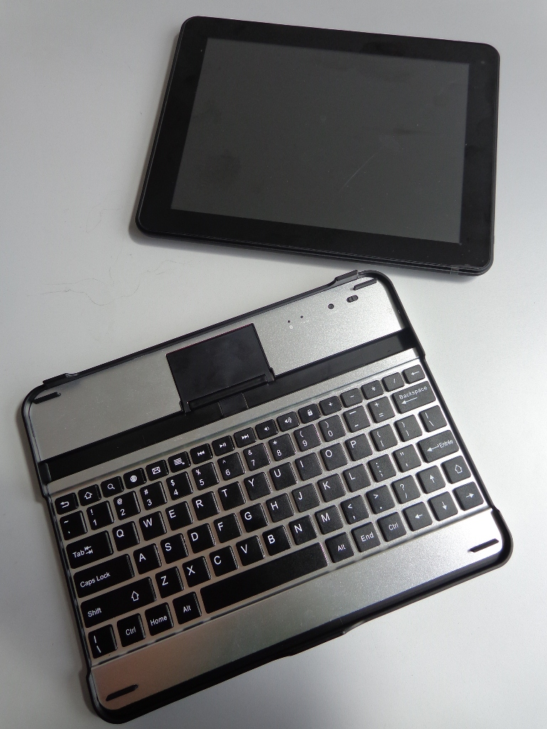 The Polaroid Executive 9.7 sits beside its Bluetooth QWERTY keyboards.