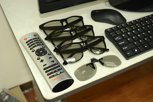 The package includes three 3D glasses, a wireless keyboard, and a wireless mouse. An additional clip-on 3D glass is also thrown-in on the bundle.