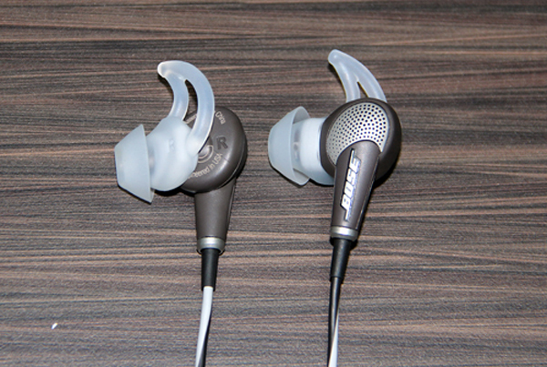 A close up view of the new Bose QuietComfort 20 earphones. The proprietary StayHear wing-like ear-tips are intended to provide a snug, noise isolating fit.