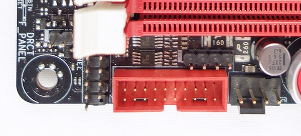 On the left of the red USB 3.0 connector, there is the front panel connector. At its top, there is the 4-pin speaker connector, and to its right, there is a chassis fan connector.