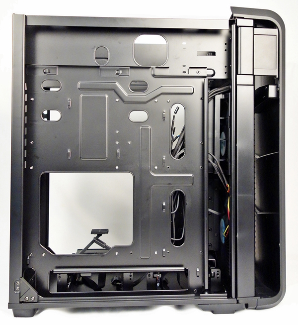 The removable motherboard tray of the Raven RV04 features a large number of cut-outs.