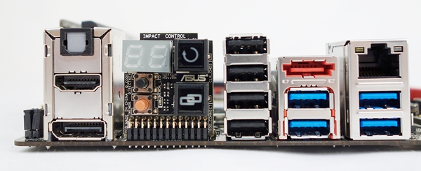 The rear I/O ports of the board, together with the daughter board that hosts a number of onboard buttons and a Q-Code debug LED display.