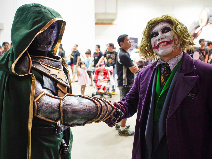 When Dr. Doom and the Joker shake hands, you know worlds are gonna collide.