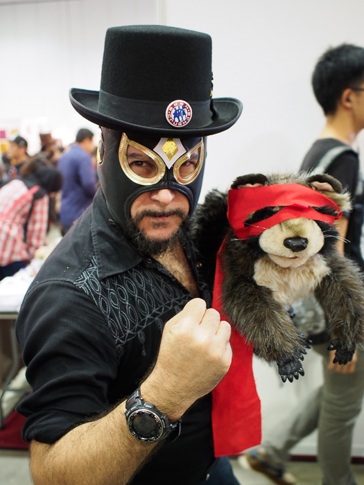 A man and his furry raccoon take on the world.