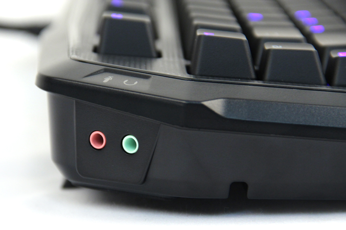 On the back left corner of the MK Pro, you'll find microphone and headphone pass-through ports. To use the ports, you'll have to connect the matching cables to the back of your computer.