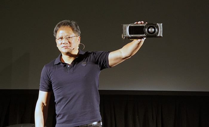 NVIDIA CEO Jen-Hsun Huang showing off the company's latest enthusiast grade graphics card.