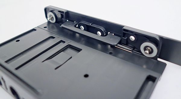 This is one of the flaps that is used to support the installed 2.5-inch drive.