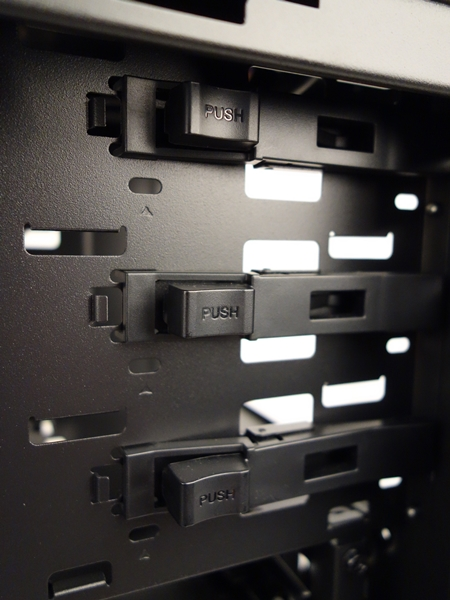 The user needs to push the button of the self-locking latch in order to release the inserted 5.25-inch drive.