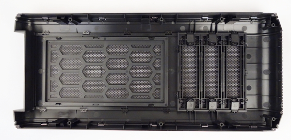 The rear of the front panel; there is a dust filter that is held in place by plastic tabs. The 5.25-inch drive bay covers are easily removed by pushing on their retaining tabs.