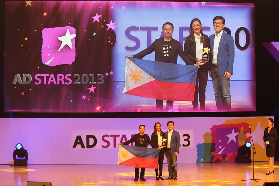 During the awarding, Creative Director Eugene Demata (left), and Chair and Chief Creative Officer Merlee Jayme (middle) at the BEXCO convention center in Busan, Korea.
