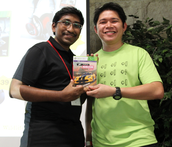 Judging from his smile, we're sure this lucky draw winner was pleased to win a copy of Forza Horizon, an Xbox 360 video game sponsored by Microsoft.