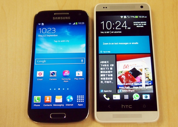 The HTC One mini (right) is slightly longer, wider, thicker and heavier than its arch rival, the Samsung Galaxy S4 mini (left).