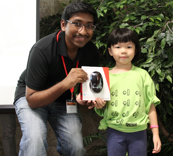 One of our younger lucky draw winners walked away with one of the five sets of Microsoft Sculpt Comfort Mouse. It'll come in handy when she surfs our forums.