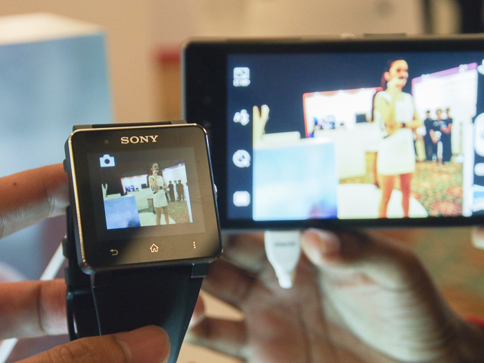 You can view a live feed from the smartphone's camera and even snap a shot using the SmartWatch 2.