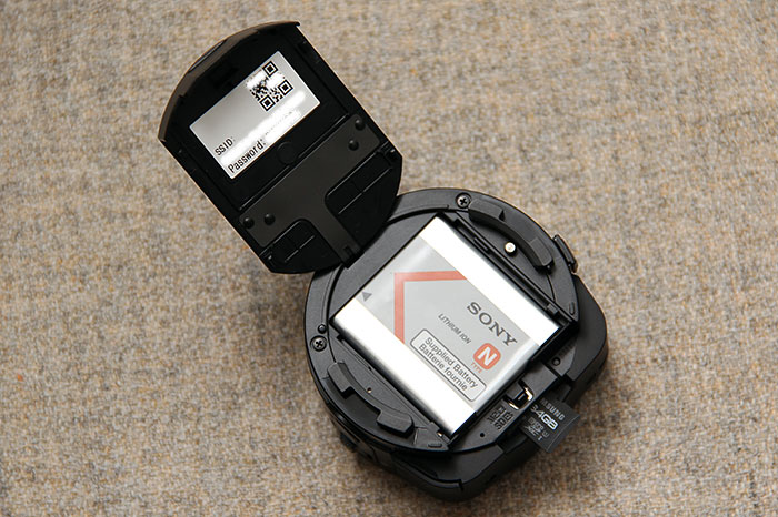 A 630mAh battery is used to power the QX10. The microSD/Memory Stick Micro card slot is also found under the compartment door.