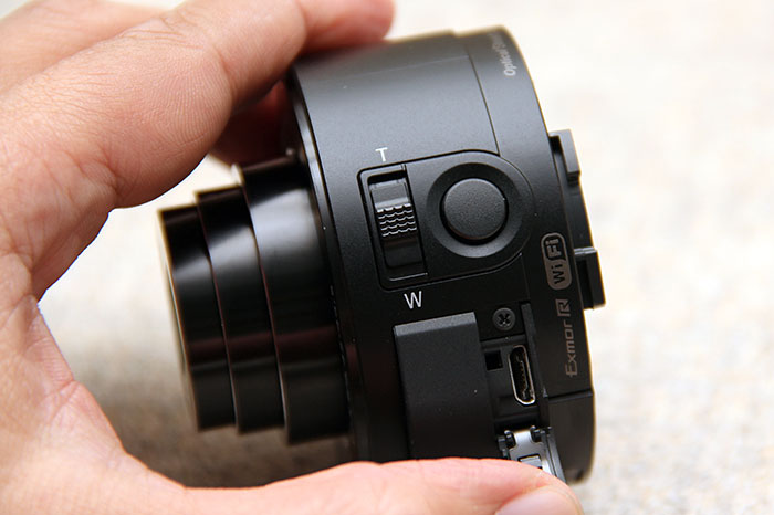 On the left, you've the zoom lever, shutter button, and micro-USB terminal (under the flap).