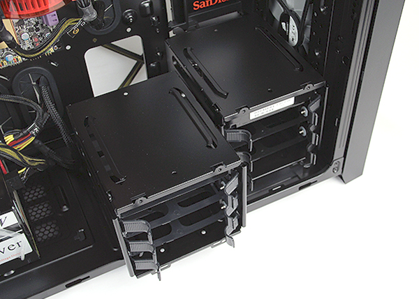 To install fans or radiators at the bottom will require users to remove the HDD cage. Fortunately they are easy to remove, simply undo two screws and slide them out.