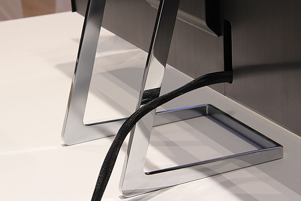 The video ports reside behind a panel at the back. Notice the brushed metal back too. The chrome stand is equally simple but elegant. And don't worry, this monitor tilts and pivots.