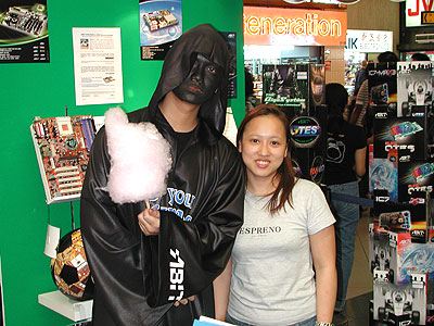 ABIT's µGuru mascot was there to grace the event. Seen here posing at the ABIT booth with a Convergent staff and... ermm.. candy floss?
