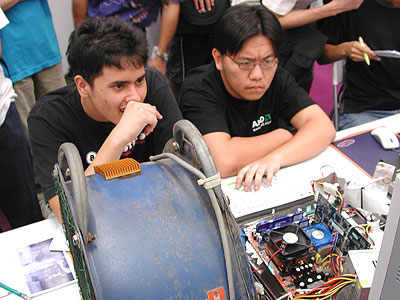 Rundymc (left) and Krado (right) were seen tweaking the system minutes before the competition began.