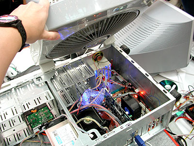 The only air-cooled setup that's fixed inside a casing. Deathgame and VincentV's strategy was to cool the critical components with localized fans and top it up with a large box fan.