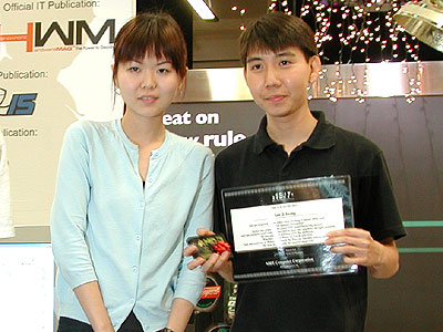 The winner for the open category was Shamino (seen here posing with Maggie Lin - the Marketing Manager for ABIT). Shamino had a perfect score of 50.