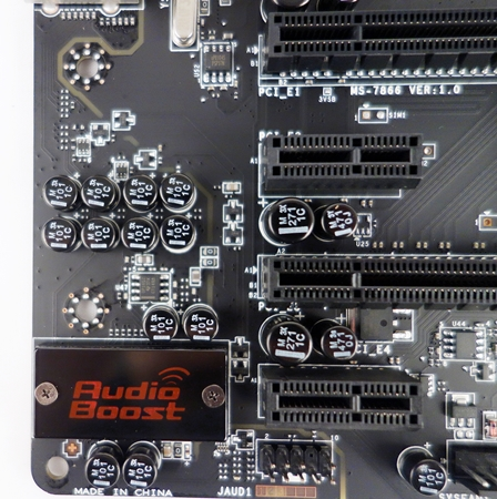 In the vicinity of the Audio Boost EMI shield for the Realtek audio chip, we see a scattering of audio capacitors (in black) that will amplify and filter the audio signals before they are routed to the audio ports.