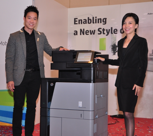 From L-R: Martin Tan, Market Development (Lead), LaserJet Hardware, Printing and Personal Systems Group, HP Malaysia; and Wai Mun Loh, Country Category Manager, HP Printers and Personal Systems, HP Malaysia with the HP Color LaserJet Enterprise flow M880z.