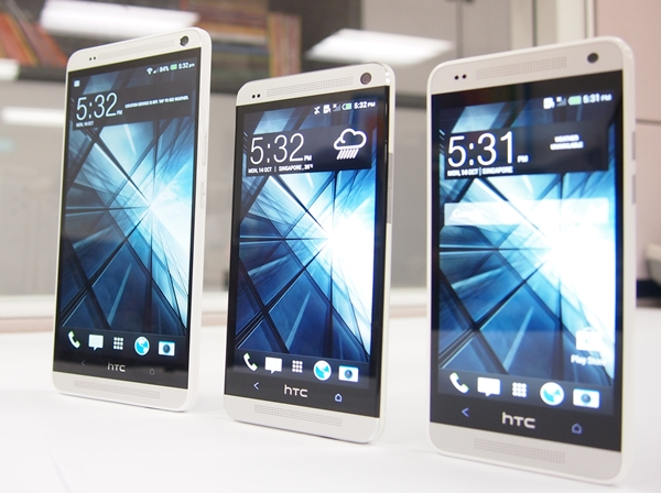 The three musketeers of the HTC One family. <br> Left to right: HTC One Max, One, One Mini.