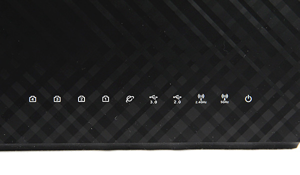 The router has a distinctive checkered, honeycomb pattern that ASUS has been using on its recent routers. Also, it features numerous LED status lights which lets the user know if everything is working as intended.