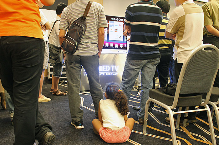 In the midst of adults, we spotted this little girl, who seemed very interested in the TV demos. It's good to start young.